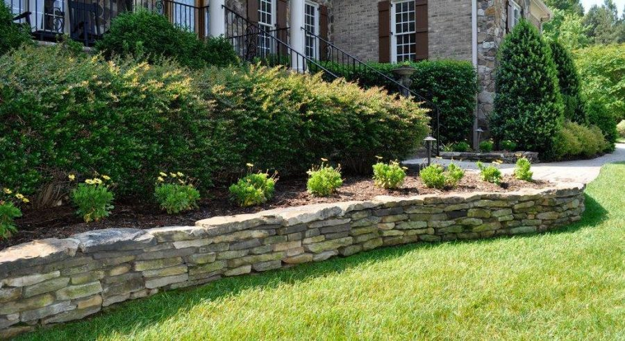 Custom retaining wall design and installation to help enhance the beauty of your yard landscape.